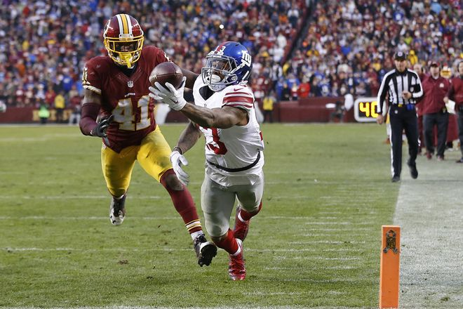 Nov 29, 2015; Landover, MD, USA; New York Giants wide receiver Odell Beckham (13) catches a touchdown pass as Washington Redskins cornerback Will Blackmon (41) defends in the fourth quarter at FedEx Field. The Redskins won 20-14. Mandatory Credit: Geoff Burke-USA TODAY Sports
